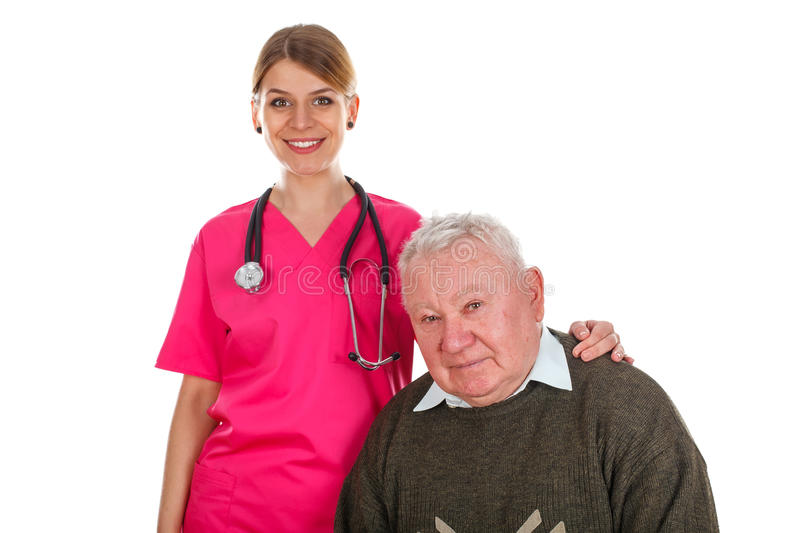 Elderly care. Picture of an old men with his smiling caregiver royalty free stock photo