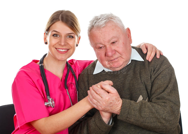 Elderly care. Picture of an old men with his smiling caregiver - isolated background royalty free stock photos
