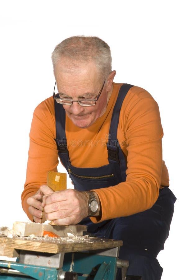 Elderly carpenter royalty free stock photo
