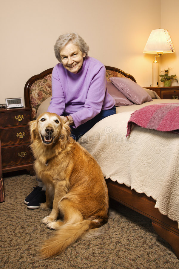 Free Elderly Caucasian Woman In Bedroom With Dog. Stock Photo - 2037450
