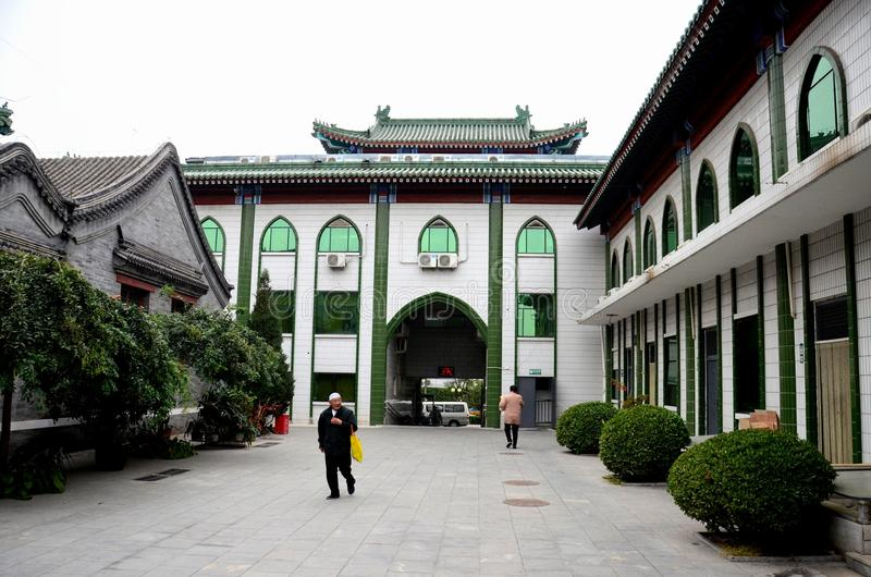 Elderly Chinese Muslim man walks in entrance courtyard of mosque Beijing China stock photos