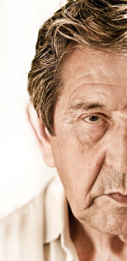 Elderly closeup sad man's face royalty free stock images