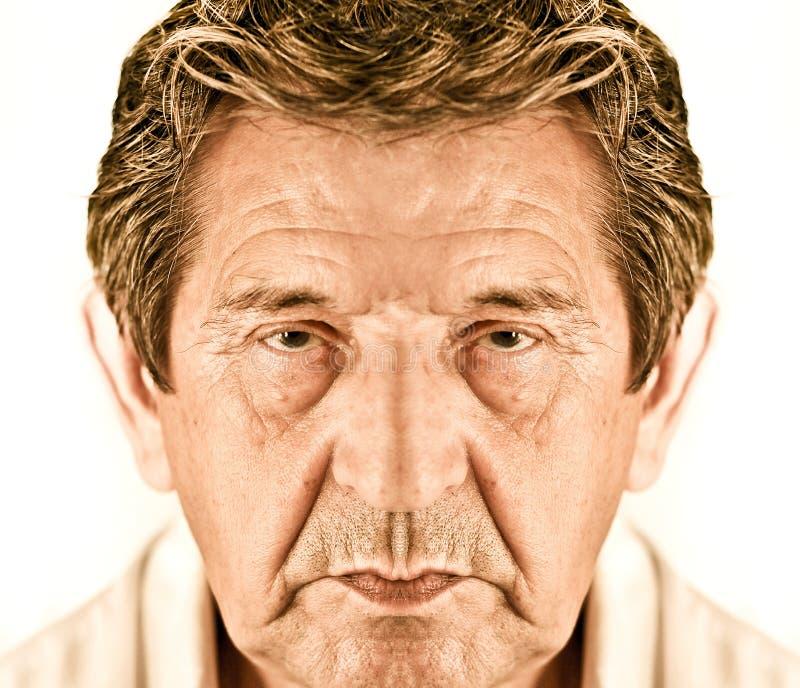 Elderly closeup sad man's face stock photo