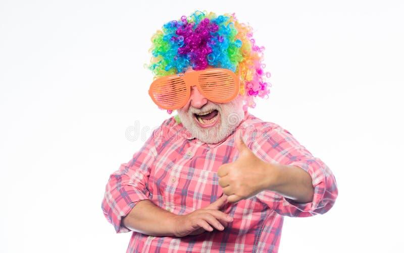 Elderly clown. Having fun. Funny lifestyle. Fun and entertainment. Comic grandfather concept. Nice joke. Grandpa always stock photography