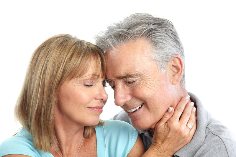 Elderly couple. Happy elderly seniors couple in love. Isolated over white background royalty free stock photos