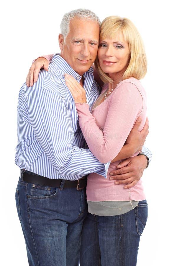 Elderly couple. Happy elderly seniors couple in love. Isolated over white background stock images