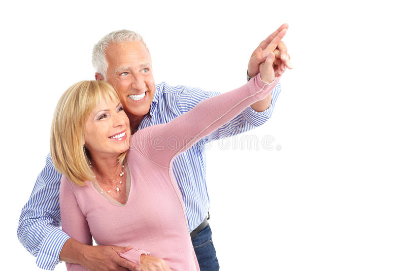 Elderly couple. Happy elderly seniors couple in love. Isolated over white background royalty free stock photo