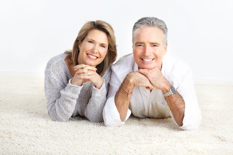 Elderly couple. Happy elderly seniors couple at home stock image