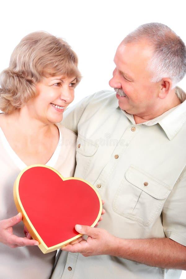 Elderly couple. Happy elderly seniors couple in love. Isolated over white background royalty free stock photography