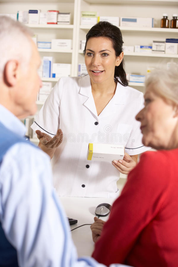 Elderly couple at American pharmacy stock image