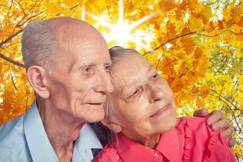 Elderly couple on autumn landscape stock image