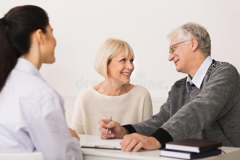 Elderly Couple Buying Medical Health Insurance And Consulting Broker stock photo
