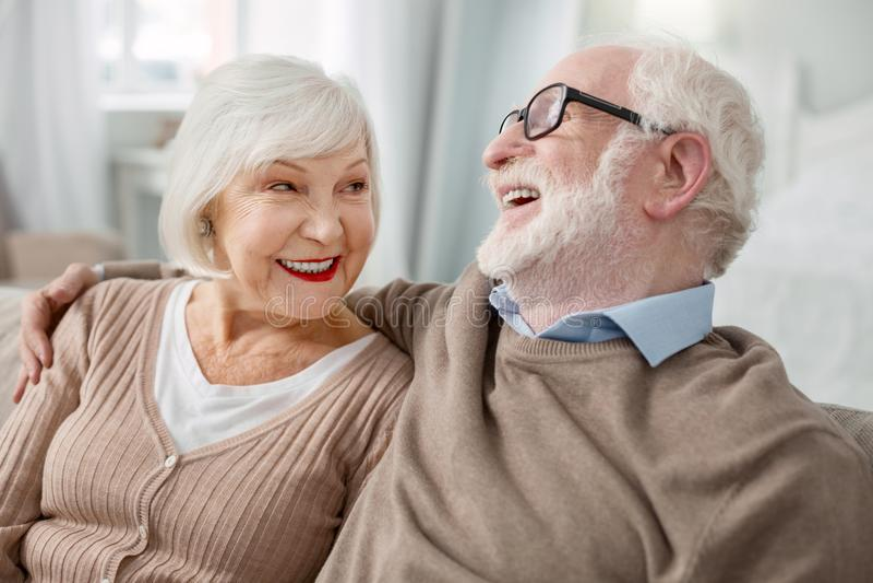Cheerful elderly man hugging his wife stock photos