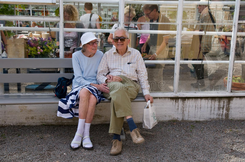 Elderly Couple in City Park, Stockholm, Sweden royalty free stock image