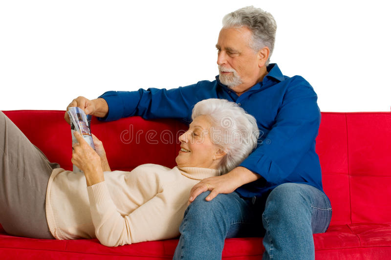 Elderly couple on the couch royalty free stock images
