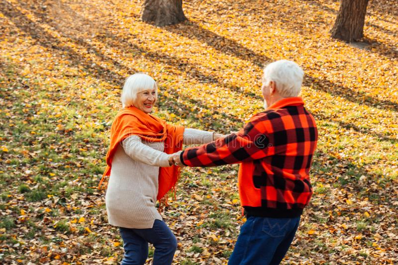 An elderly couple is dancing. Smiling old woman. Movement is life. I feel young again stock photography