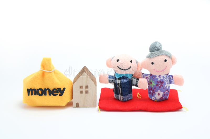 Elderly couple of dolls. And the house and the money royalty free stock image
