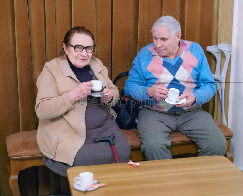 Elderly couple drinking coffee in a diner royalty free stock photo