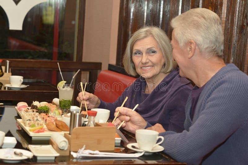 Elderly couple eating stock image