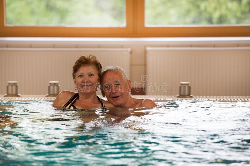 Elderly couple in pool stock image