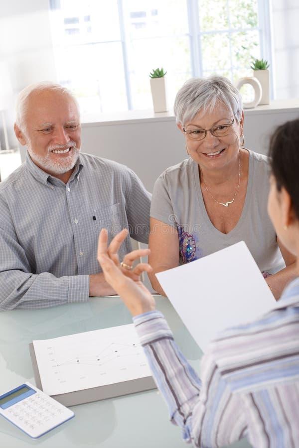 Elderly couple at financial consultation royalty free stock photos