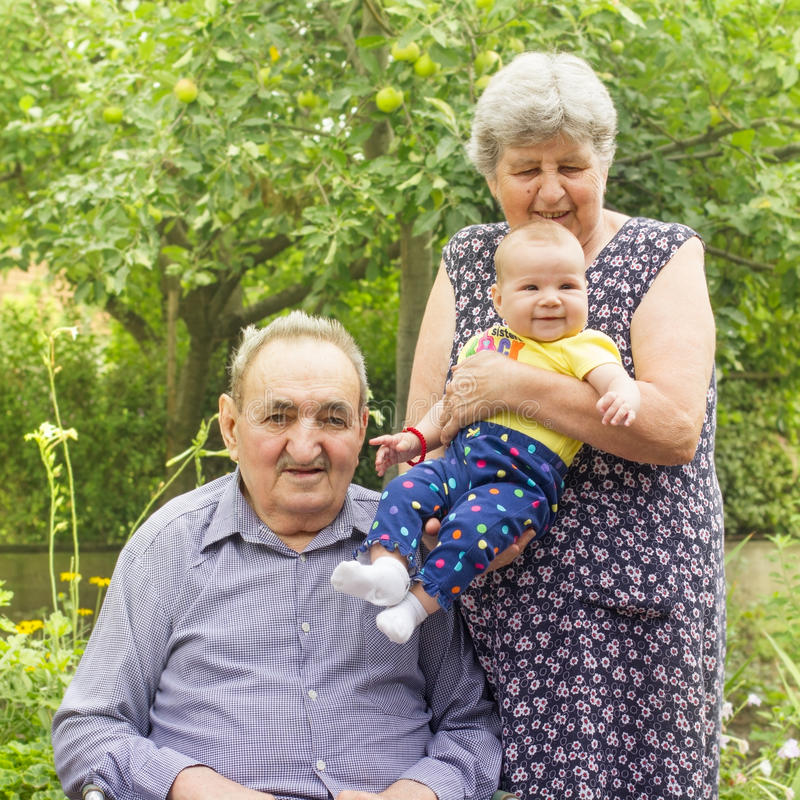 Download Elderly Couple With Granddaughter Stock Photo - Image: 26254932
