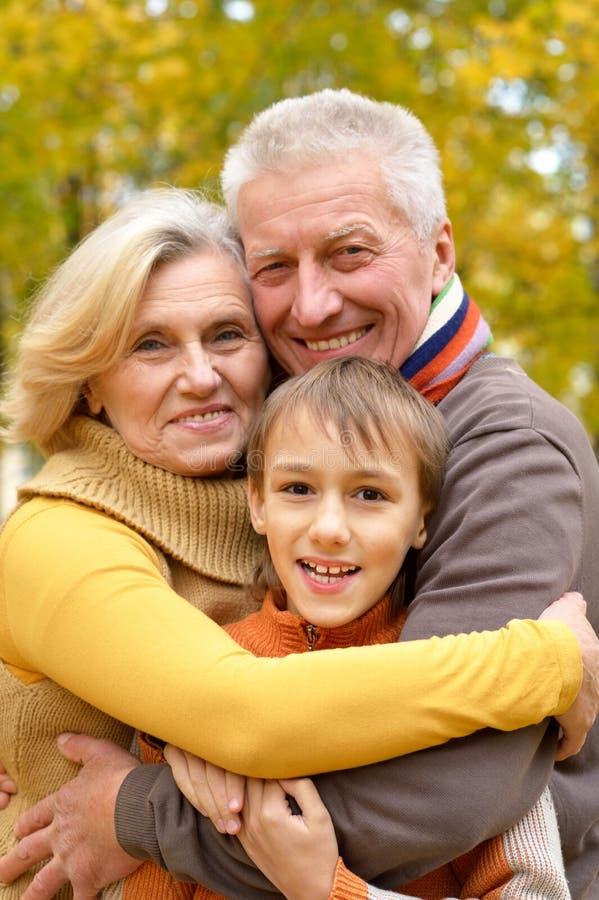 Elderly couple and grandson stock photos