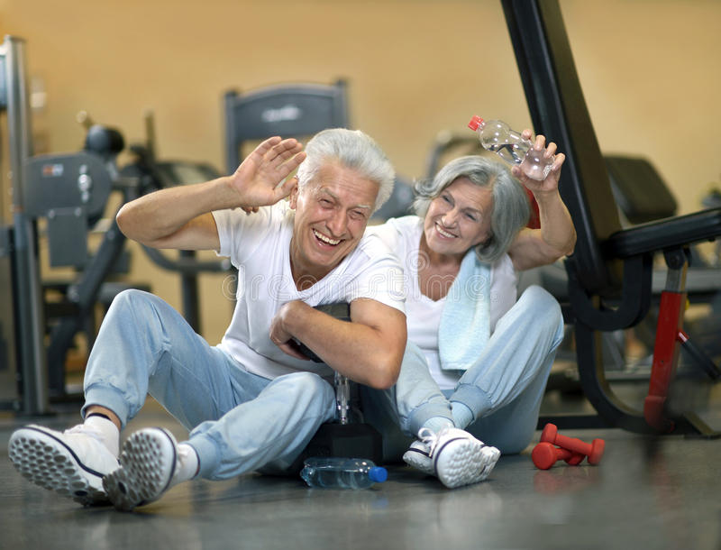 elderly couple in the gym royalty free stock photos