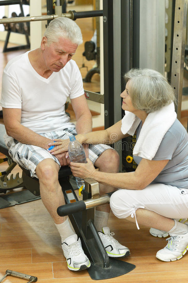 Elderly Couple In A Gym Stock Photo