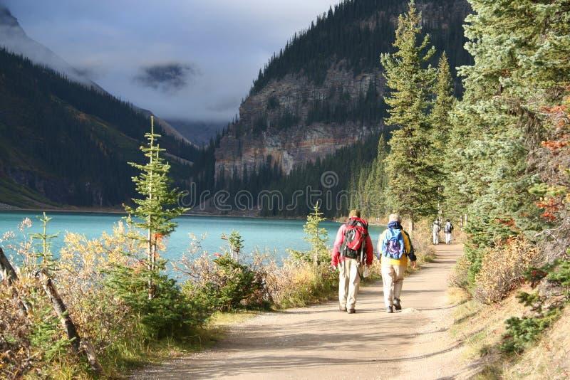 Elderly couple hiking royalty free stock photography
