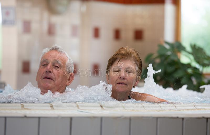 Elderly couple in jacuzzi royalty free stock images
