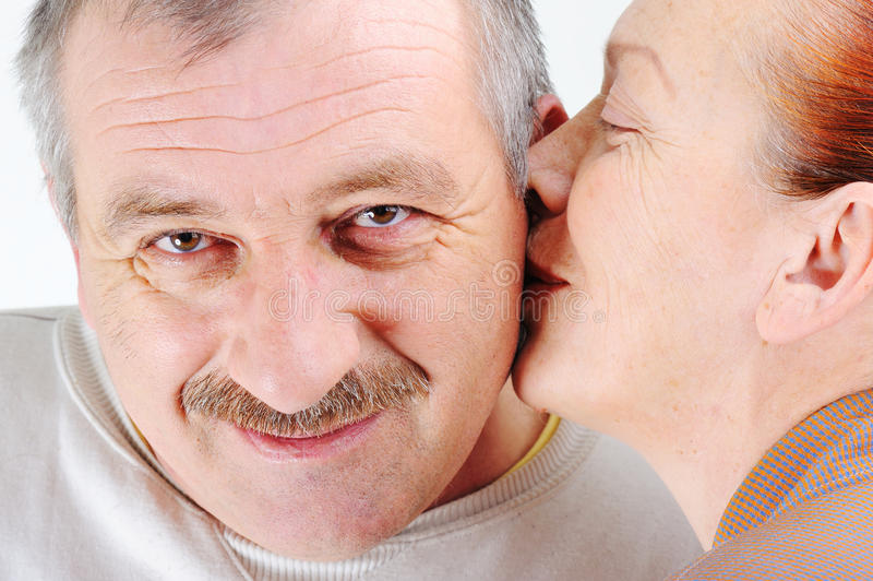 Elderly couple kissing royalty free stock photos