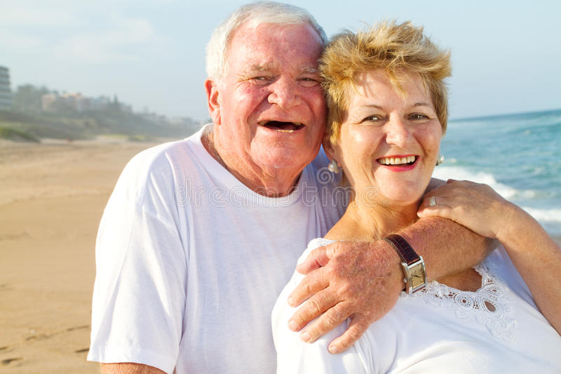 Elderly couple laughing stock photos