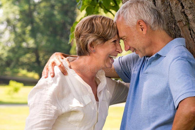 Elderly couple laughing head to head royalty free stock image
