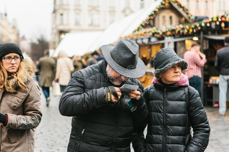 An elderly couple is looking at a map. stock photos