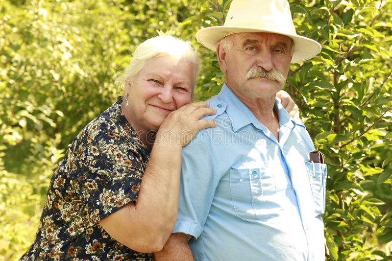 Elderly couple in love outdoors royalty free stock images