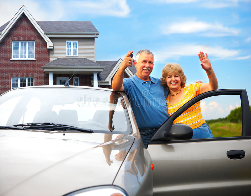 Elderly couple near their home stock images