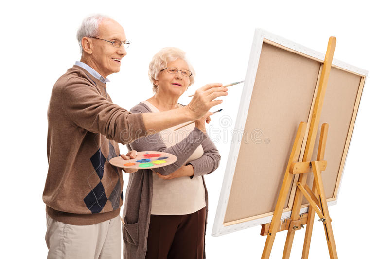 Download Elderly Couple Painting Together Stock Photo