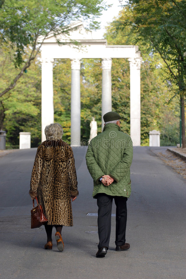 Elderly couple in the park royalty free stock image