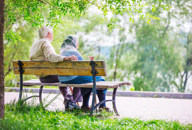 Elderly couple at the park stock photos