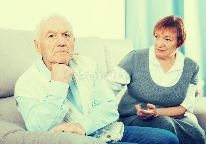 Elderly couple quarrel royalty free stock photography