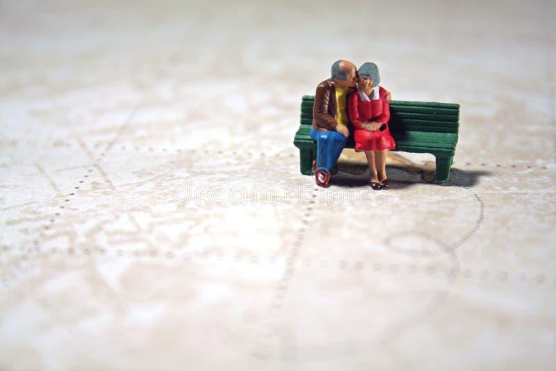 Elderly Couple Remembers Travels Stock Photos