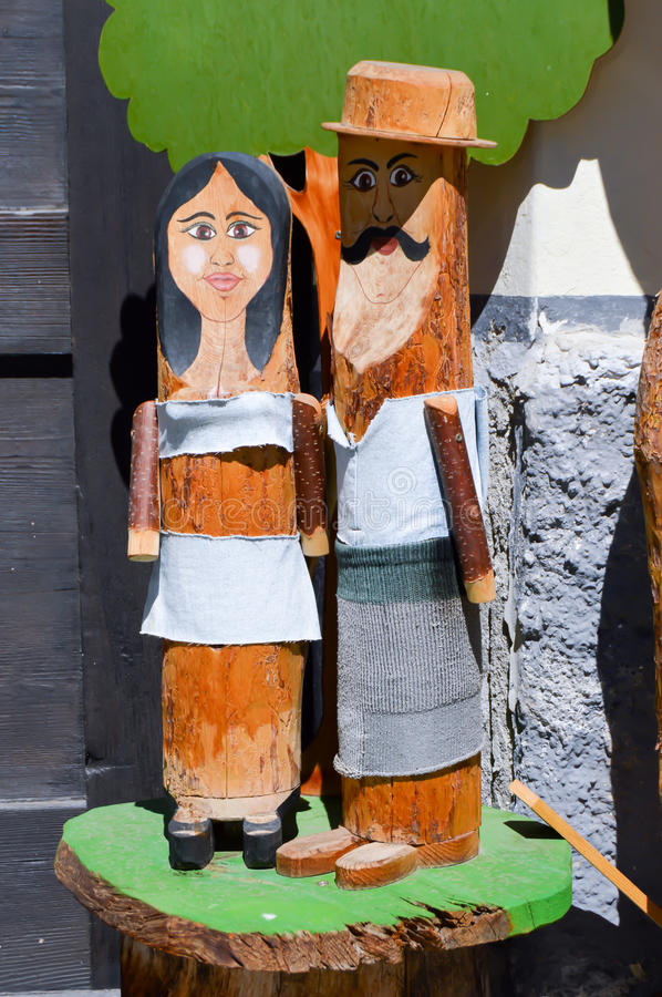 Elderly couple replicated in tree trunks. Of tyrol in Austria royalty free stock images