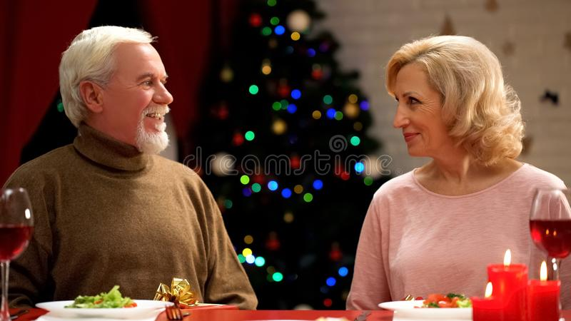 Elderly couple on romantic date at Christmas night, love through years, family royalty free stock photo