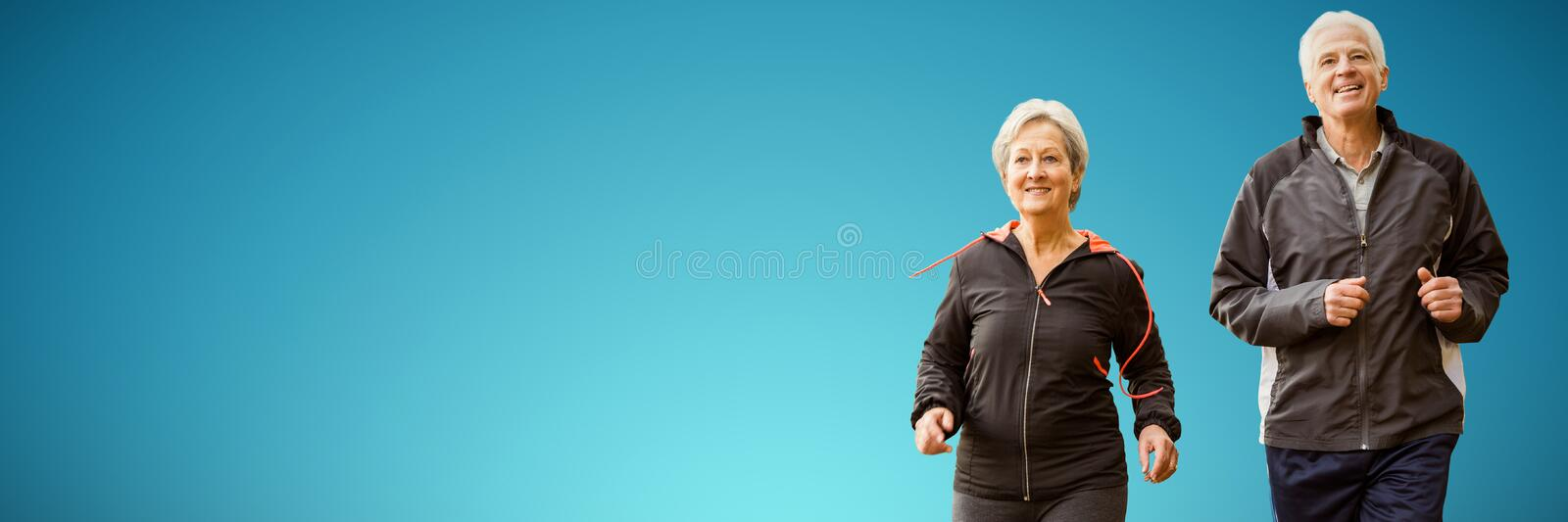 Composite image of elderly couple running together royalty free stock photo