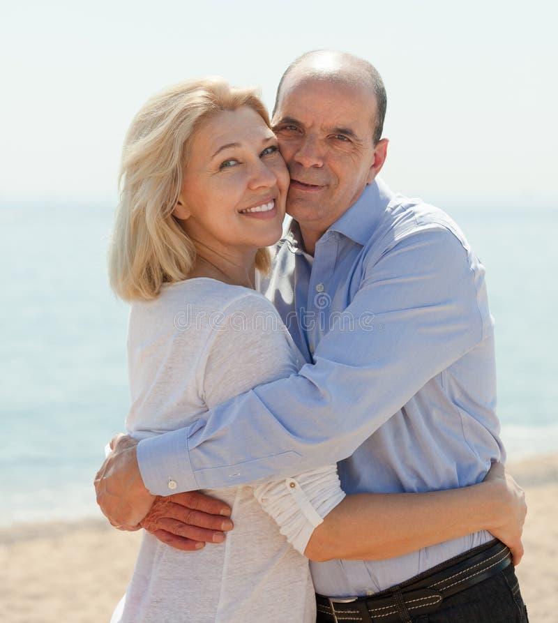 Elderly couple at sea shore stock photography
