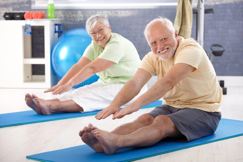 Elderly Couple Stretching Royalty Free Stock Photos