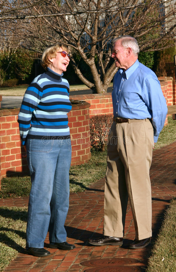 Elderly couple talking stock photography