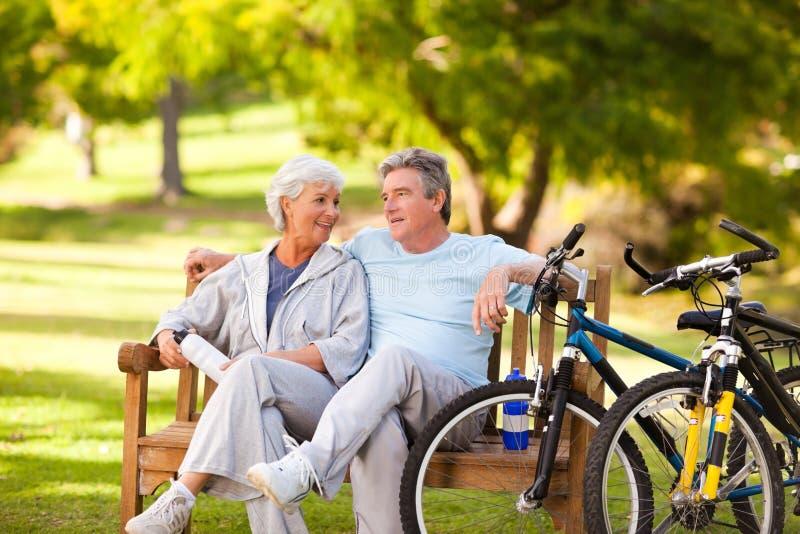 Elderly couple with their bikes stock photo