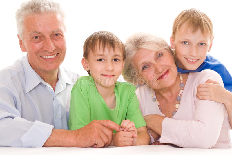 Elderly couple with their grandchildren royalty free stock photos